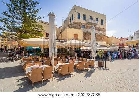 CHANIA, GREECE - APRIL 3, 2017 : Restaurants on the street of Chania on Crete, Greece. Chania is the second largest city of Crete and the capital of the Chania regional unit.