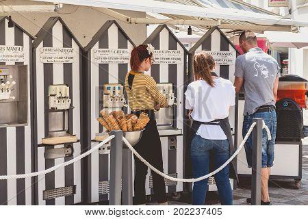 Italian Ice-cream Seller And His Employees