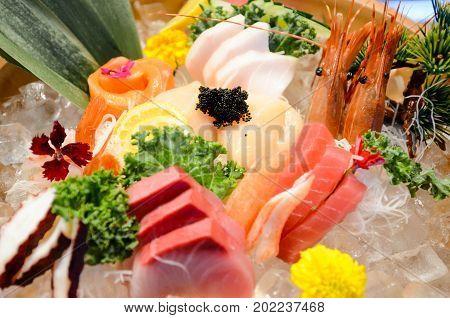 Sashimi Matsu with tuna, yellowtail, super white tuna, sweet shrimp and salmon in big Bowl