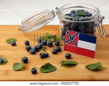 Mississippi Flag On A Wooden Plank With Blueberries Isolated On White