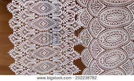 White lace fabric. Traditional work. Background. Textile.