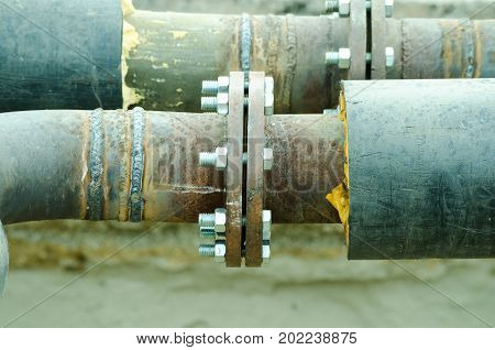 Two welded pipes with bolts and insulation close up