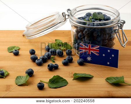 Australian Flag On A Wooden Plank With Blueberries Isolated On White