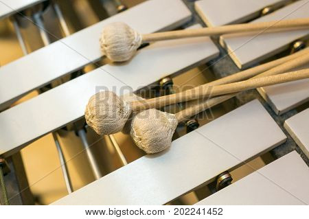 xylophone musical chromatic instruments concept - closeup on wooden bars with mallets glockenspiel marimba balafon semantron pixiphone education and orchestra concert usage top view.