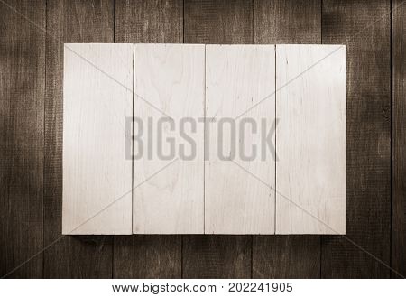 board panel on wooden background