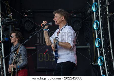 Kiev Ukraine - June 28 2017: Popular Ukrainian rock band Tabula Rasa and her frontman and vocalist Oleg Laponogov perform at the Atlas festival at the National Expocenter.