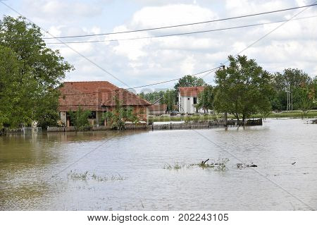 The consequences of flooding flooded house and street