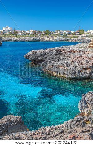 Mediterranean Sea small cove with crystal clear water in the region of Ciutadella, Menorca island, Spain.