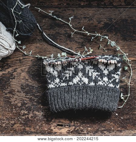 Unfinished Knitted Cap On Knitting Needles
