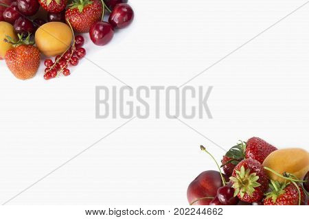 Various fresh summer berries. Ripe strawberries redcurrants apricots nectarines and cherries on white background. Berries and fruits with copy space for text. Background berries.