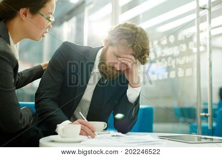 Businesswoman encouraging her colleague during work in office