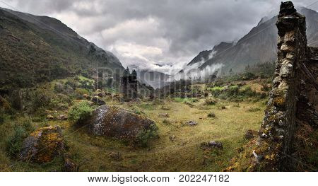 Fog and rain in the Peruvian mountains. Archaeological site Qolqas Penas in rio Tancacc valley near Machu Picchu and Ollantaytambo, Peru