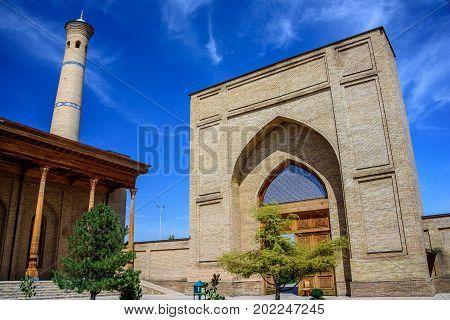 Mosque with carved columns of sandalwood, minaret and entrance of Hazrat Imam Ensemble in the center of Tashkent city, Uzbekistan
