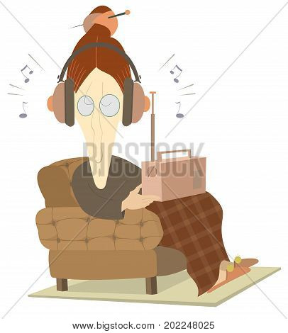 Listening the radio old woman isolated. Old woman sits in an armchair and listens the radio