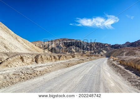 Dirt road in Twenty Mule Team Canyon in Death Valley National Park in California