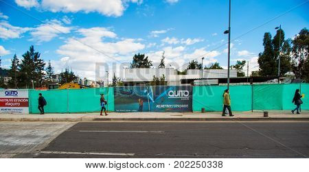 Quito, Pichincha Ecuador - August 10 2017: Unidentified people walking at exteriors of the metro construction located inside of the Carolina park north part of the city of Quito.