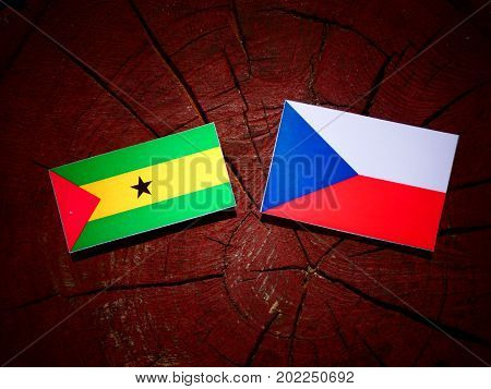 Sao Tome And Principe Flag With Czech Flag On A Tree Stump Isolated