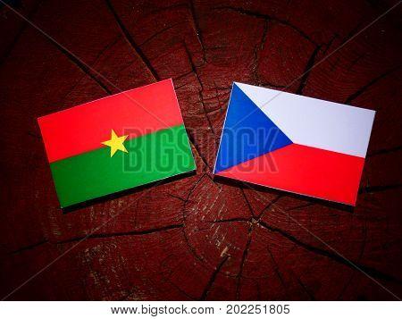 Burkina Faso Flag With Czech Flag On A Tree Stump Isolated