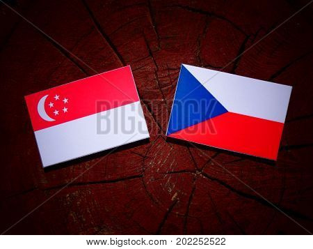Singaporean Flag With Czech Flag On A Tree Stump Isolated