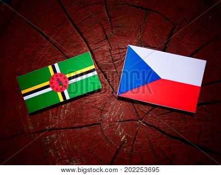 Dominica Flag With Czech Flag On A Tree Stump Isolated