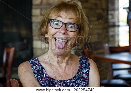 Senior Citizen Woman Acting Silly & Sticking Out Tongue