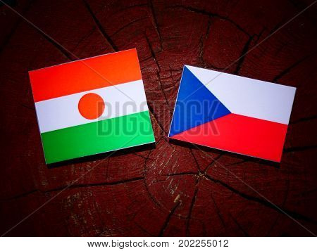 Niger Flag With Czech Flag On A Tree Stump Isolated