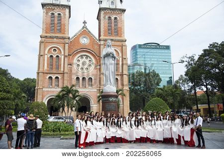 Ho Chi Minh City, Vietnam - March 27, 2017: Famous central Saigon Notre Dame Cathedral, built between 1863 and 1880 by French colonists, is one of Saigon's architectural marvels