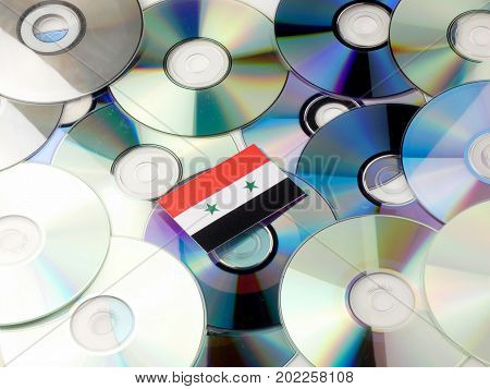Syria Flag On Top Of Cd And Dvd Pile Isolated On White