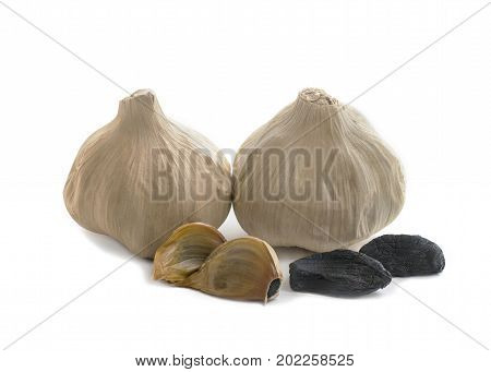 Whole bulb of home fermented Black Garlic with cloves latest wonder food rich in antioxidants vitamins and minerals. Isolated on white background