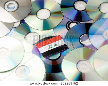 Iraqi Flag On Top Of Cd And Dvd Pile Isolated On White