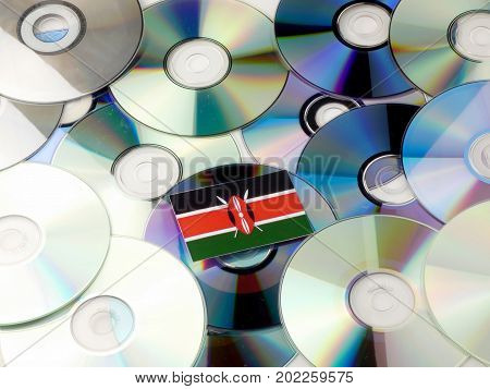 Kenyan Flag On Top Of Cd And Dvd Pile Isolated On White