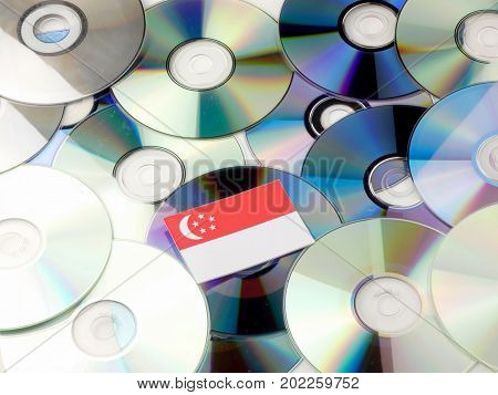 Singaporean Flag On Top Of Cd And Dvd Pile Isolated On White