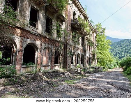 Old abandoned buildings in sunny summer day. Dead city at Abkhazia