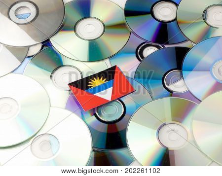 Antigua And Barbuda Flag On Top Of Cd And Dvd Pile Isolated On White