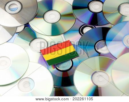 Bolivian Flag On Top Of Cd And Dvd Pile Isolated On White