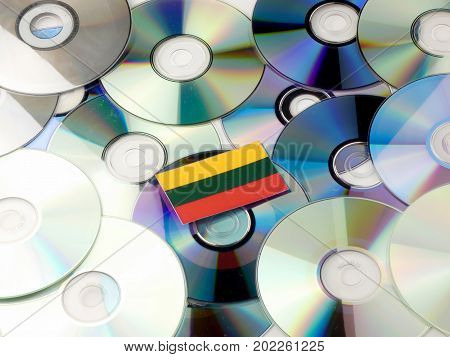 Lithuanian Flag On Top Of Cd And Dvd Pile Isolated On White