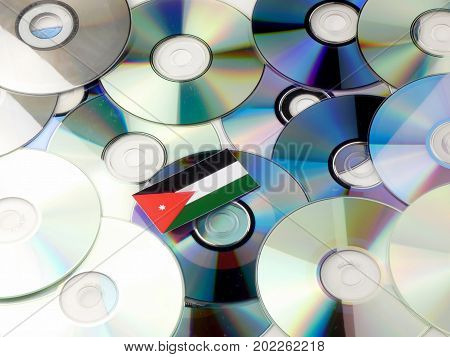 Jordanian Flag On Top Of Cd And Dvd Pile Isolated On White