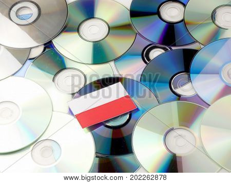 Polish Flag On Top Of Cd And Dvd Pile Isolated On White