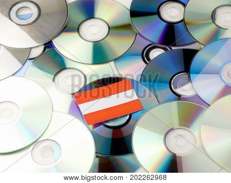 Austrian Flag On Top Of Cd And Dvd Pile Isolated On White