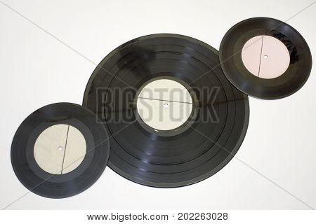 Vinyl Records Of Different Sizes. Lay Diagonally