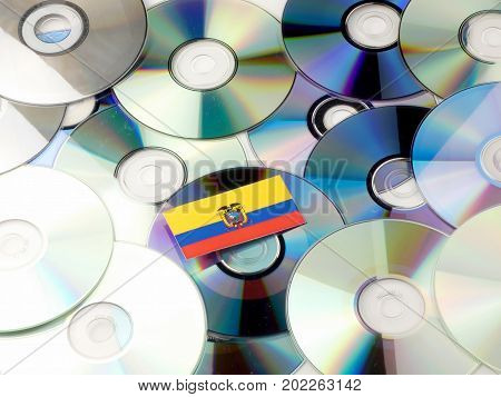 Ecuador Flag On Top Of Cd And Dvd Pile Isolated On White