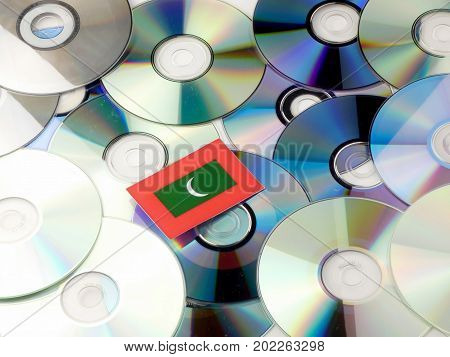Maldives Flag On Top Of Cd And Dvd Pile Isolated On White