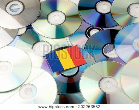 Romanian Flag On Top Of Cd And Dvd Pile Isolated On White