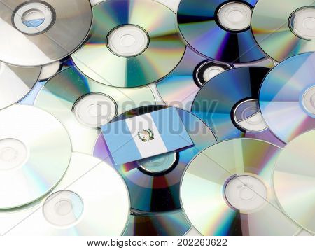 Guatemalan Flag On Top Of Cd And Dvd Pile Isolated On White