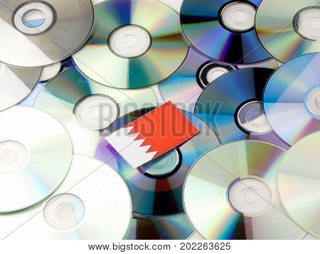 Bahrain Flag On Top Of Cd And Dvd Pile Isolated On White