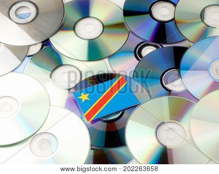 Democratic Republic Of The Congo Flag On Top Of Cd And Dvd Pile Isolated On White