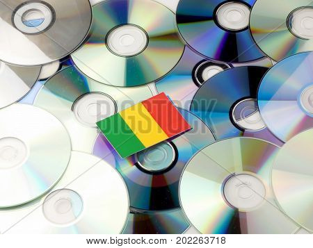 Malian Flag On Top Of Cd And Dvd Pile Isolated On White
