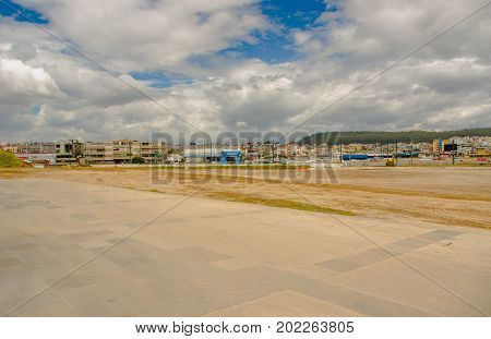 Quito, Pichincha Ecuador - August 27 2017: Land where is the metro construction located inside of the Bicentenario park, with a city of Quito behind, at north part of the city of Quito.