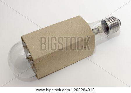 Huge Incandescent Light Bulb In A Corrugated Cardboard Box