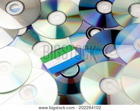 Sierra Leone Flag On Top Of Cd And Dvd Pile Isolated On White